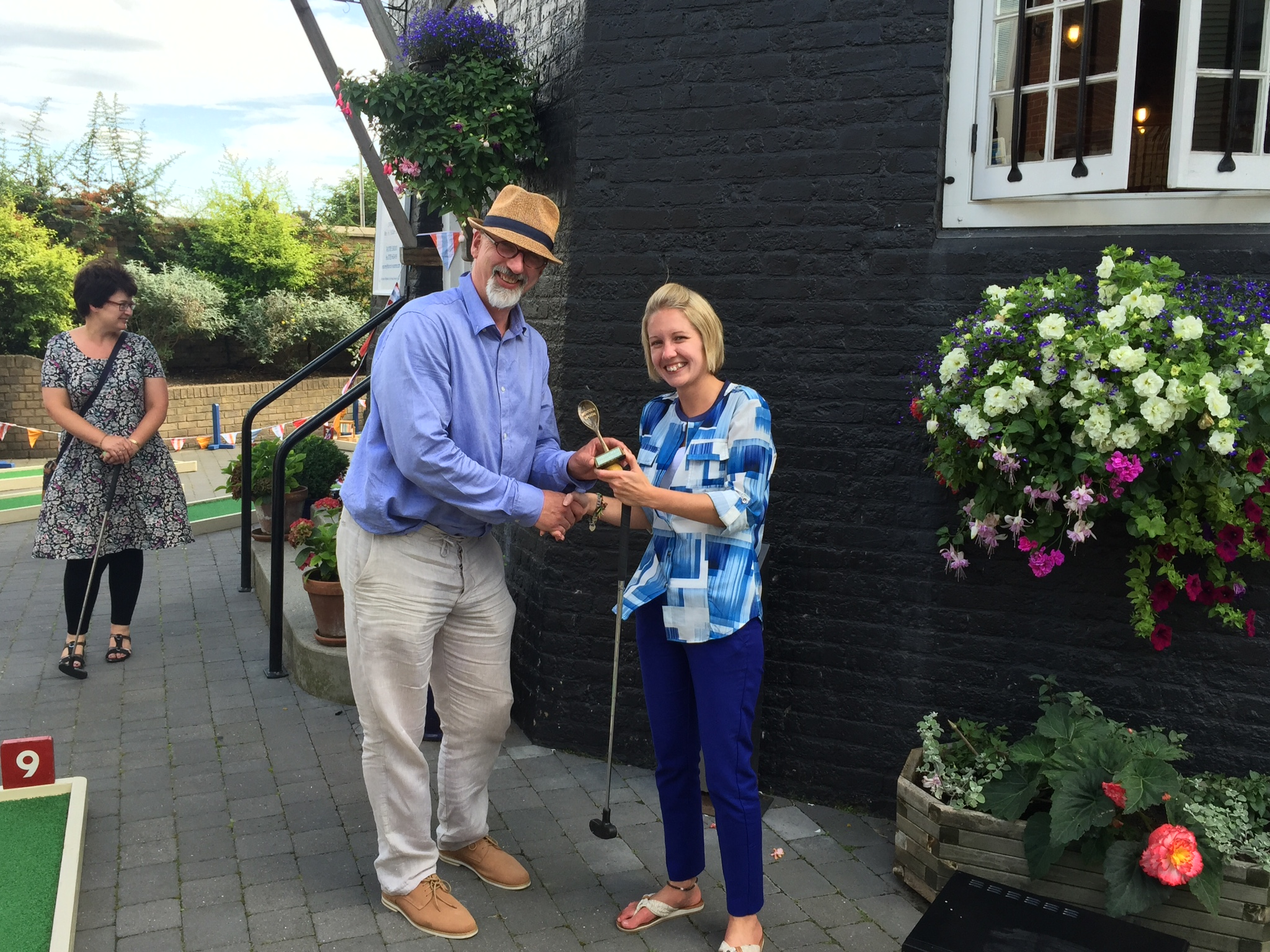 Andrew Nixon of Crazy Golf 4 U presenting Alice Thompson with her Wooden Spoon award for worst round on the day.
